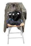 Clothes and moto helmet Stock Image
