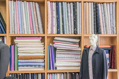 Clothes neatly folded on shelves.  Royalty Free Stock Photos