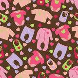 Clothes for newborn baby girl seamless pattern. Royalty Free Stock Photo