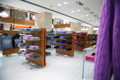 Clothes On Shelves In Shop Stock Photography