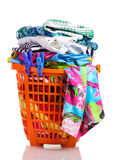 Clothes in orange plastic basket Royalty Free Stock Image