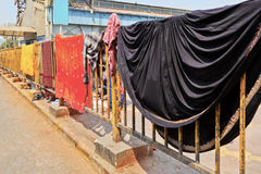 Clothes out drying at railway station railings. Mahalaxmi Station, Mumbai, India, colors of family washing out to dry on railway railings Royalty Free Stock Photography