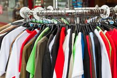 Clothes in an outlet. Colorful clothes on sale in an outlet - clearance at the end of season Stock Photo