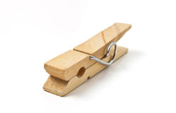 Clothes Peg. Wooden sprung Clothes Peg from low perspective isolated on white royalty free stock photos