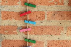 Clothes peg colorful clamps on the rope. Clothes peg colorful clamps on the rope royalty free stock photos