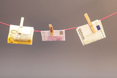 Clothes-peg and euro money Stock Photography
