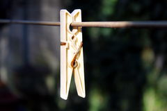 Clothes peg. Hanging on a wire Royalty Free Stock Photos