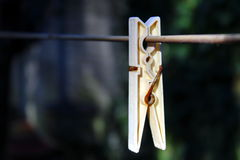 Clothes peg. Hanging on a wire Royalty Free Stock Images