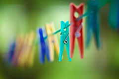 Clothes peg. On a clothes line royalty free stock photography