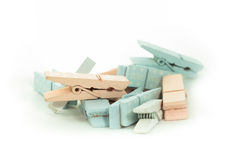 Clothes peg. A lot of decorative clothes peg, pink, blue and white. Whit legend: Sweet home Royalty Free Stock Image