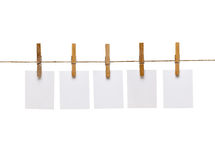 Clothes peg and note paper Stock Image
