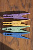Clothes-peg. Plastic clothes-peg on wood. different colors stock photos
