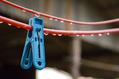 Clothes peg on red wire. Close up clothes peg on red wire royalty free stock photo