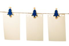 Clothes-peg. In shape of Christmas tree isolated on white background stock image