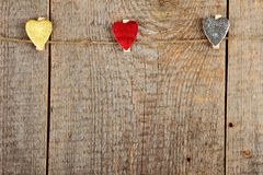 Clothes-peg. In shape of heart on old wooden background royalty free stock photography