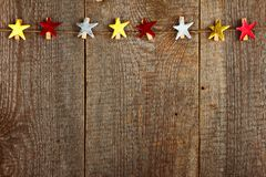 Clothes-peg. In shape of star on old wooden background royalty free stock photography