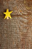 Clothes-peg. In shape of star on old wooden background stock photos