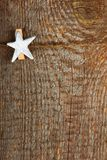 Clothes-peg. In shape of star on old wooden background royalty free stock images