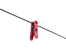 Clothes-peg on the wire Royalty Free Stock Photo