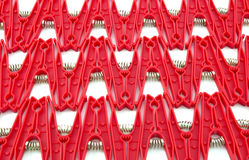 Clothes pegs. Red clothes pegs on the front line Stock Photos