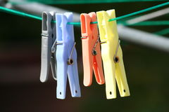Clothes Pegs. A photo showing 4 clothes pegs hanging on a washing line Royalty Free Stock Photos