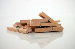 Clothes Pegs. A pile of wooden clothes pegs on a white background Royalty Free Stock Photos