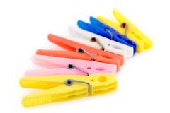 Clothes pegs. Against white background royalty free stock images