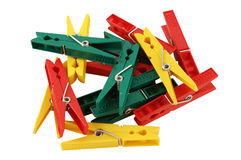 Clothes pegs. Different coloured clothes pegs, isolated Stock Images