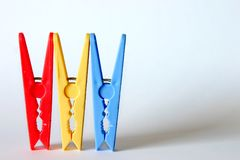 Clothes Pegs. Three Clothes Pegs Together Stock Photography