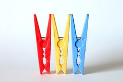 Clothes Pegs. Three Clothes Pegs Lined Up Royalty Free Stock Photo