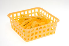 Clothes-pegs in basket Royalty Free Stock Photos