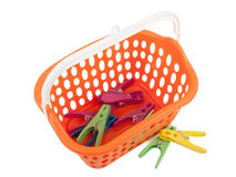 Clothes pegs and basket Stock Image