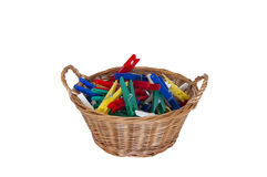 Clothes pegs in basket cut out Royalty Free Stock Images