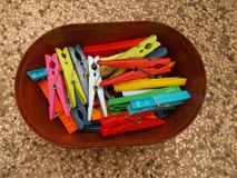Clothes pegs in a box. Colorful clothes pegs in a box stock photo