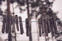Clothes pegs on clothes line Stock Images