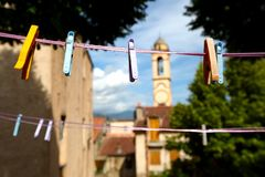 Clothes pegs on clothes line with church Royalty Free Stock Image