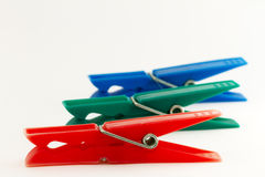 Clothes pegs - clothes pins. 3 clothes clothes pegs. Neutral background Stock Images