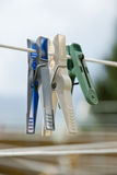 Clothes pegs on the clothesline Stock Photo