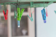 Clothes pegs or clothespins hang on a cord. Plastic clothes pegs. On a washing line.selective focus Royalty Free Stock Photos