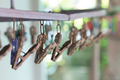 Clothes pegs or clothespins hang on a cord. Plastic clothes pegs. On a washing line.selective focus Stock Photos