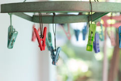Clothes pegs or clothespins hang on a cord. Plastic clothes pegs. On a washing line.selective focus Royalty Free Stock Images