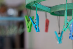 Clothes pegs or clothespins hang on a cord. Plastic clothes pegs. On a washing line.selective focus Stock Image