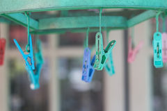 Clothes pegs or clothespins hang on a cord. Plastic clothes pegs on a washing line.& x28;selective focus& x29 Royalty Free Stock Photo