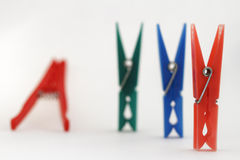 Clothes pegs in different colors Royalty Free Stock Images