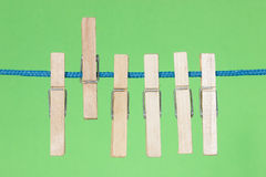 Clothes pegs  on the green background Royalty Free Stock Photo