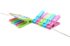 Clothes-pegs isolated on a white background. Royalty Free Stock Photo