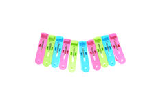 Clothes-pegs isolated on a white background. Royalty Free Stock Photos