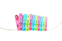 Clothes-pegs isolated on a white background. Stock Photography