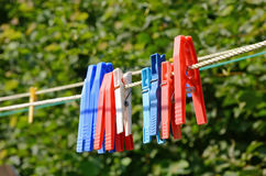 Clothes pegs, laundry pins. On the line Royalty Free Stock Images