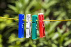 Clothes pegs on a line Royalty Free Stock Photography